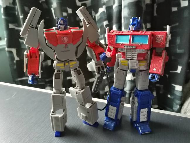 PlayStation Optimus Prime beside the Earthrise-range version of the same character