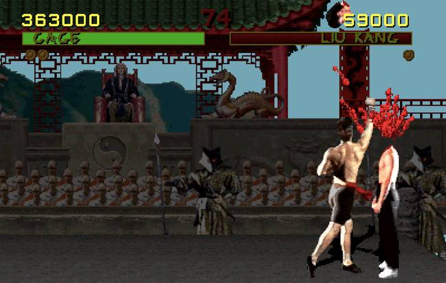 Johnny Cage's fatality takes Liu Kang's head off / Credit: Midway, Warner Bros. Interactive Entertainment