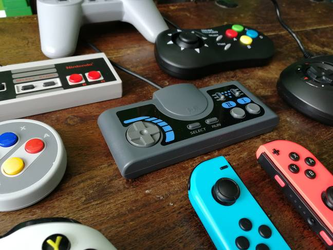 The PC Engine CoreGrafx Mini's controller, beside other pads