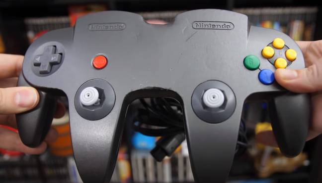 Stop Skeletons From Fighting holding the modded N64 controller
