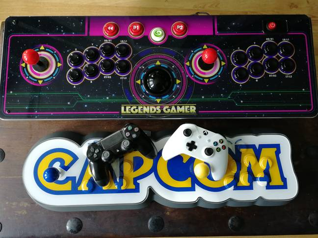 The Legends Gamer Pro next to the Capcom Home Arcade, and console controllers / Credit: the author