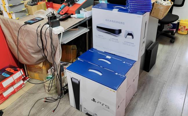 PlayStation 5 consoles stacked up at a store in the Gulou area in Beijing / Credit: Chang Liu