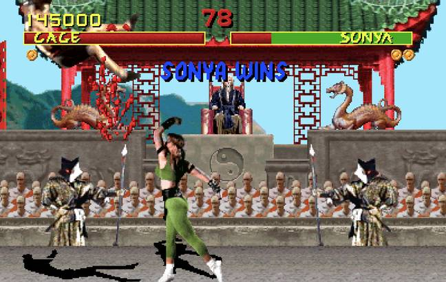 Sonya Blade finishes off Johnny Cage / Credit: Midway, Warner Bros. Interactive Entertainment